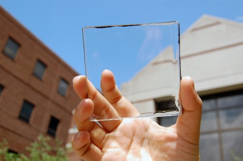 Solar power with a view: MSU doctoral student Yimu Zhao holds up a transparent luminescent solar concentrator module. Credit: Yimu Zhao via Sciencedaily.com